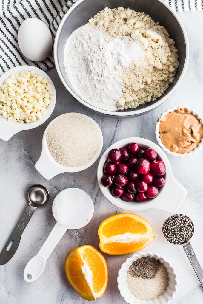 Ingredients for Cranberry Orange Thumbprint Cookies arranged in individual dishes.
