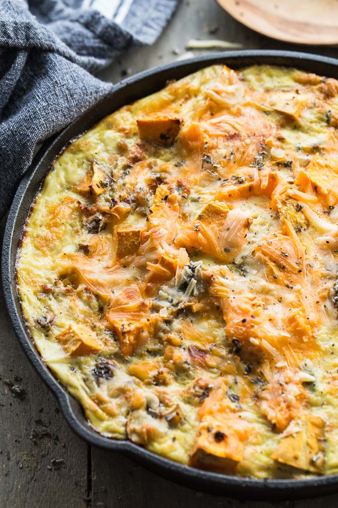 Up-close view of Sweet Potato Turkey Egg Bake in a cast iron skillet.