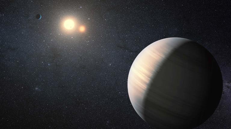 Vue d'artiste de deux exoplanètes en orbite autour d'une paire de naines rouges.