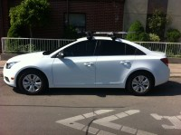Maxandrelax's White Cruze with Thule Aeroblade and bike racks