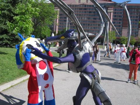 Persona_4_vs_Metroid_-_Teddy_vs_Godzilla_[Anime_North_2013_Cosplay]