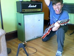 Toby in front of the Marshall JCM 900 Stack