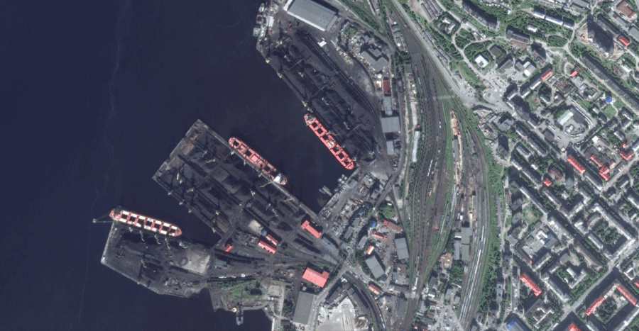 Bulk carriers load ore at the port in Murmansk, on Russia's Northern Sea Route.