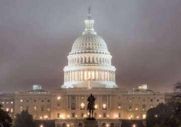 The building of the U.S. Congress at night.