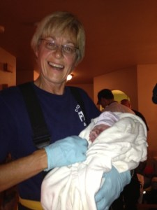 Firefighter Sue Richardson holds Baby Boyll.