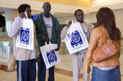 """Reese Witherspoon, starring as a social worker in """"The Good Lie"""" movie greets three Sudanese refugees at a Kansas airport."""