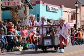 Halloween in Manitou Springs, four bloody nurses push a coffin with Emma inside