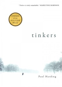 Book jacket of Tinkers by Paul Harding, small figure in a wintry white world with a few bare trees on each side.