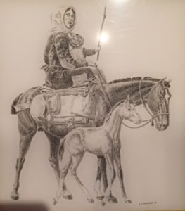 Illustration of peasant girl on donkey with colt next to her. Done in pen and ink.