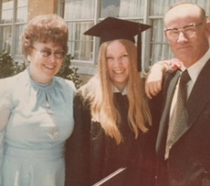 C.S. Boyll on graduation day, with parents Ben and Rosalie. The author is thankful they provided an opportunity they didn't have.