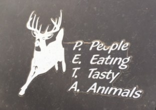 "A leaping white deer on a black background has white letters P.E.T.A. with ""People Eating Tasty Animals."""