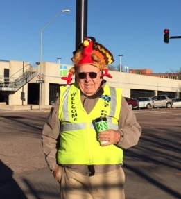Church hospitality guy Dave Fischer wears a large turkey cap.