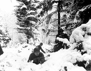 American soldiers of the 290th Infantry Regiment 75th Division photographed in the Ardennes during the Battle of the Bulge. {Amonines, Belgium 4 January 1945}