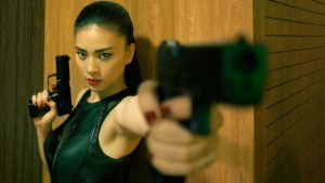 Woman points gun slightly away from camera