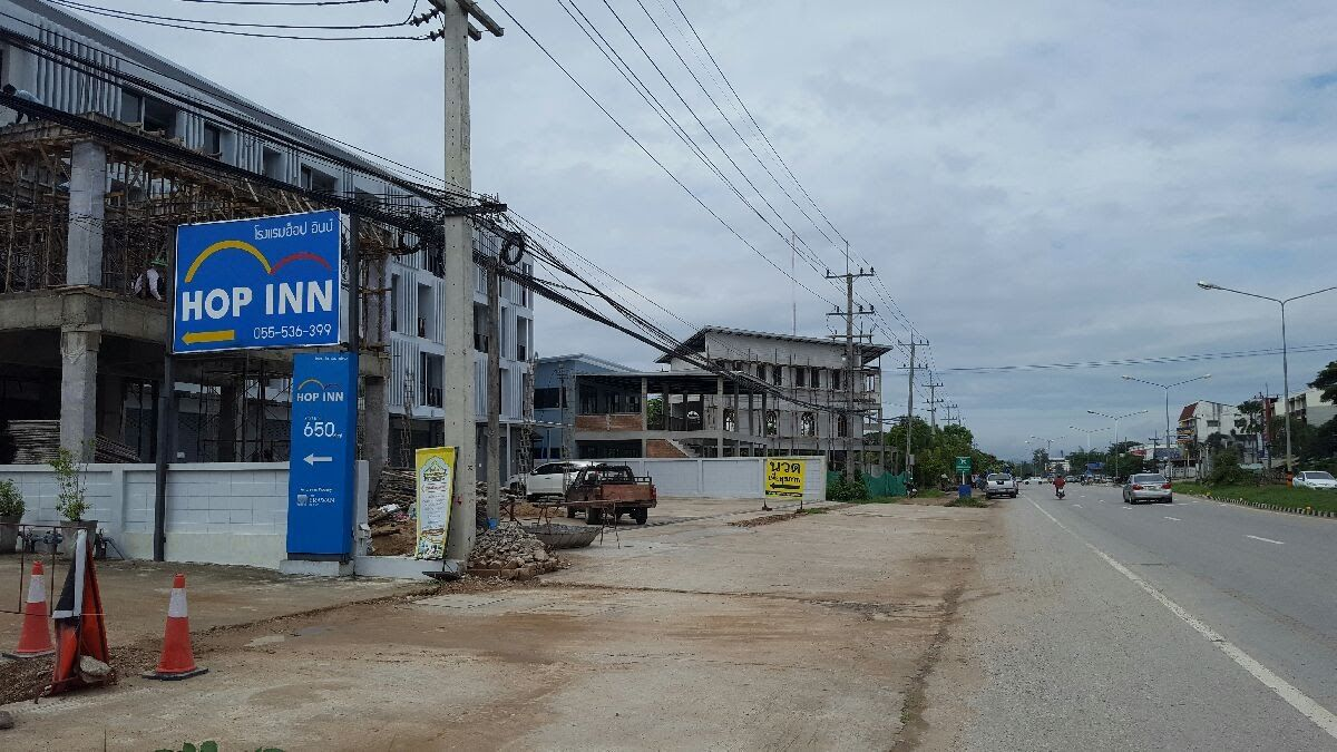 Residential area under development along the side of the Asian Highway, Thailand