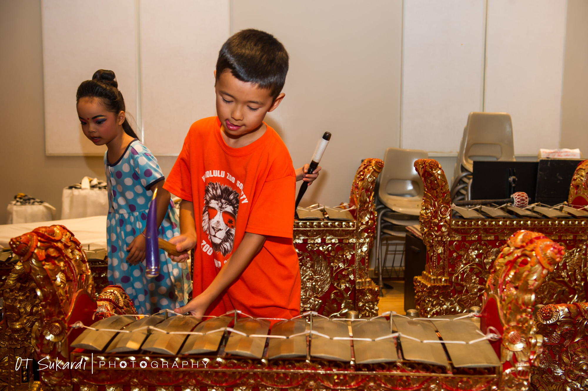 Young boy hammers on part of gamelan