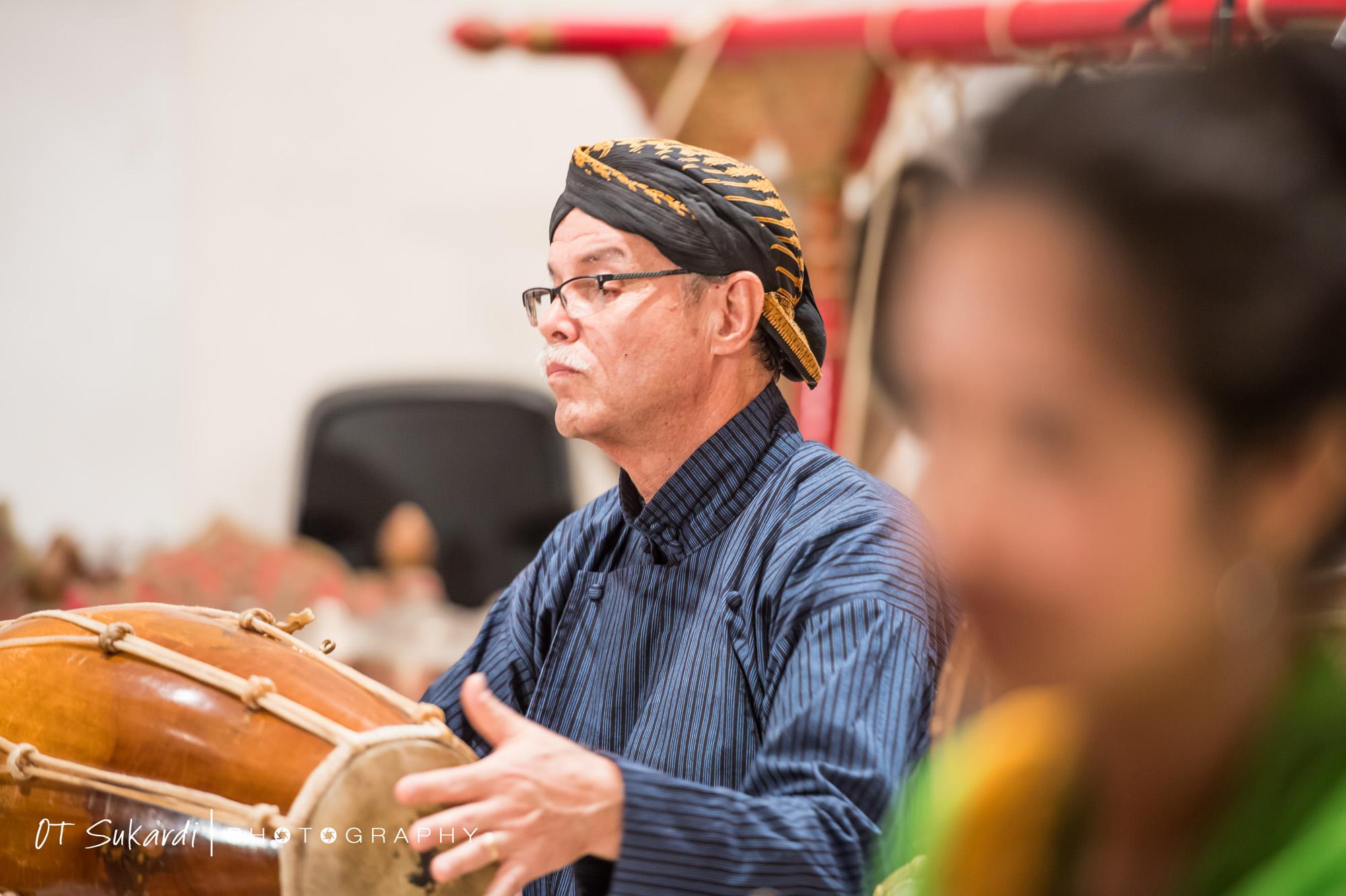 close up of man playing drum