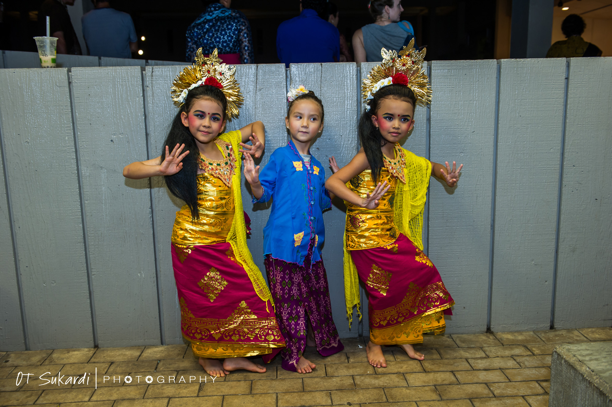 young girl performers pose in costume