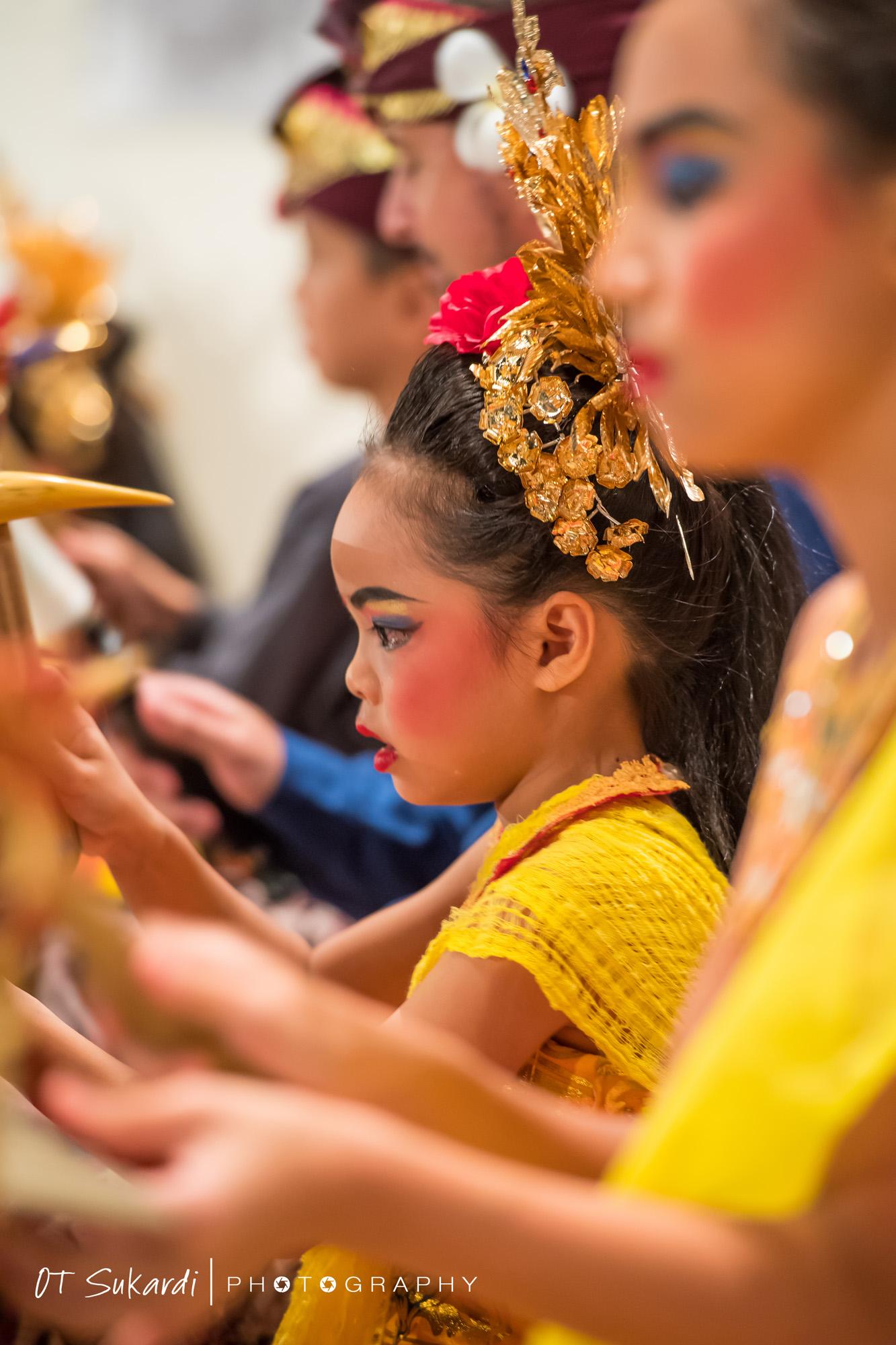 close up of young girl playing gamelan