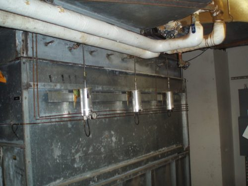 small resolution of photo 3 an old texas multi zone mz system illustrating the mz damper actuators and hot water piping routed to one reheat coil in the ductwork above