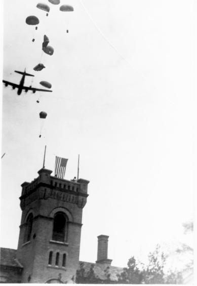 Allied parachute drop over Block 23 of the Courtyard of the Happy Way - courtesy of Weihsien-Paintings