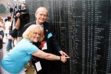 James Taylor and Mary Taylor Previte find their names engraved in marble on the monument wall. - courtesy of Weihsien-Paintings