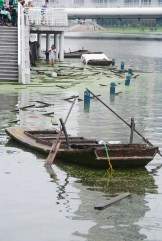 A fisherman salvages his boat after the flood - photo by C.S. Hagen