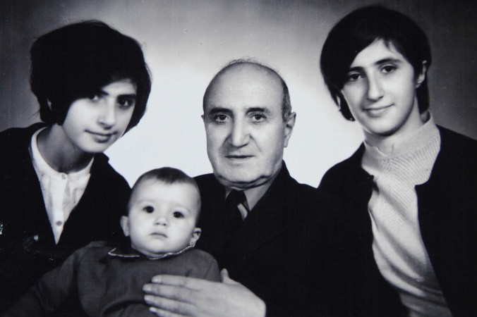 Twin sisters, Marine and Karine Pirumova, with father and brother