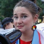 Divergent movie series heroine Shailene Woodley during a protest in Bismarck, ND - courtesy of online sources