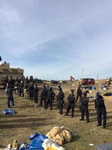 "Law enforcement entering ""Treaty Camp - photo by Margaret Landin"