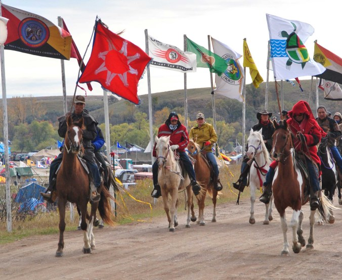 Riders set off through main entrance to Big Camp - photo by C.S. Hagen