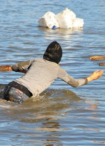Activist plunging into the creek - photo by C.S. Hagen