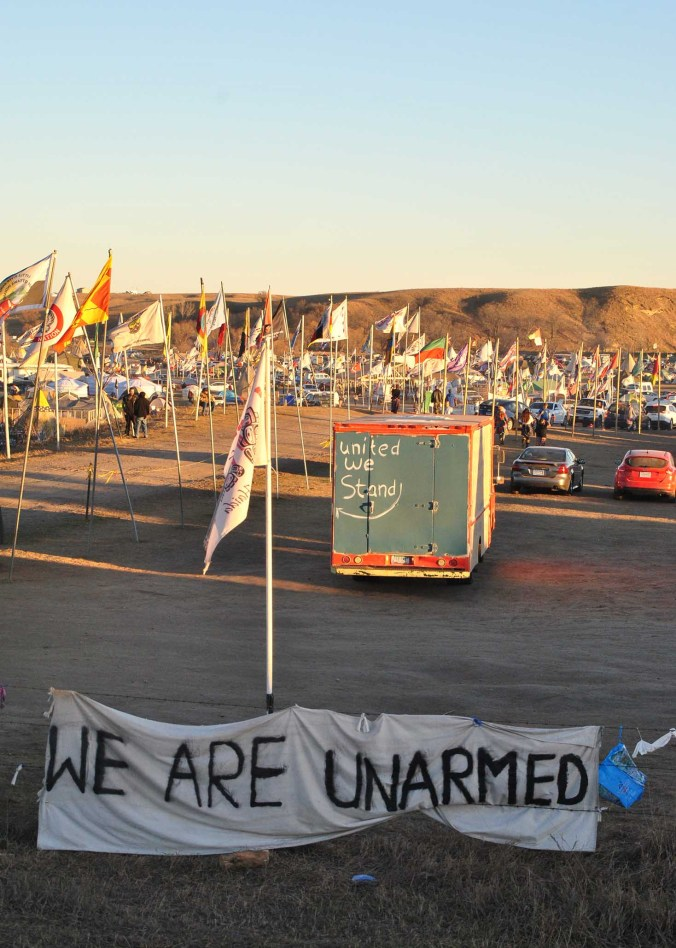 Signs outside of Oceti Sakowin - photo by C.S. Hagen