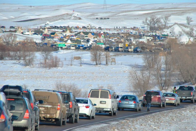 Carvan to Standing Rock, from early morning until late night, the thousands of vehicles streetched for more than a mile - photo by C.S. Hagen