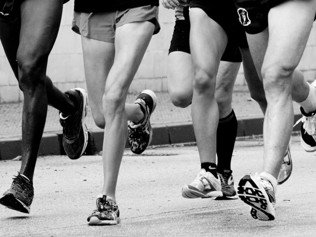 legs four long distance runners in motion