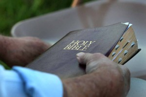 man-hands-holding-bible