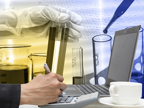 Businessman using the laptop with Chemical Laboratory