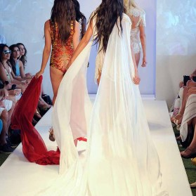 MIAMI, FL - JULY 16: Models walk the runway at Yas Couture by Elie Madi at the Art Hearts Fashion Miami Swim Week At W Hotel Presented By Planet Fashion TV at W Hotel on July 16, 2016 in Miami, Florida. (Photo by Arun Nevader/Getty Images for Art Hearts Fashion)