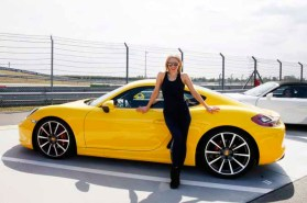 LEIPZIG, GERMANY - JULY 11: German actress Julia Dietze in front of a Porsche 911 Carrera S, wearing a total look from the Porsche Design Woman SS17 Collection at the 'Porsche Experience For Women' Event on July 11, 2016 in Leipzig, Germany. (Photo by Isa Foltin/Getty Images for Porsche AG & Porsche Design)