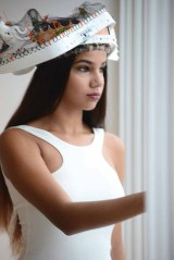 Julissa Ragunauth wears a hat created by artist Daniel Lanzilotta.