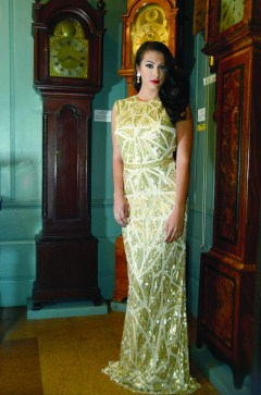 A little bit of art deco as Alyssa Taglia poses in this golden gown inside the American Clock and Watch Museum in Bristol.