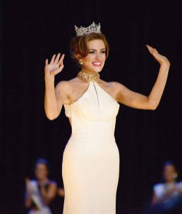 Miss America 2016 Betsy Cantrell ends the first night of Miss America preliminary competition by waving farewell to the audience at Boardwalk Hall in Atlantic City.