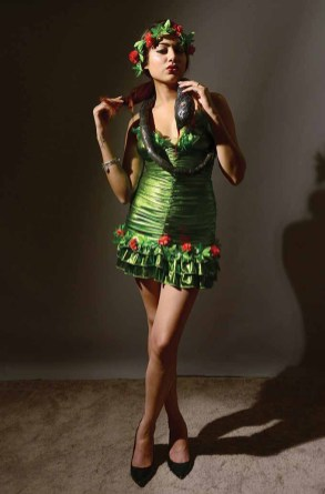 Model Rozana Tamis dresses like one of the original female superheroes... Eve from the Garden of Eden fame. She poses with that slithering Satan posing as a serpent. The costume is available at Tina's Fine Lingerie and Swimwear in Middletown (Photo by Mike Chaiken)