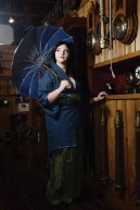 Model Cassidee Knapik in clothes from Midnight Orchid. She is holding a pagoda parasol from Canes Enable.