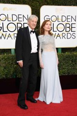 """Nominated for BEST PERFORMANCE BY AN ACTRESS IN A MOTION PICTURE – DRAMA for her role in """"Elle,"""" actress Isabelle Huppert attends the 74th Annual Golden Globe Awards with Paul Verhoeven at the Beverly Hilton in Beverly Hills, CA on Sunday, January 8, 2017."""