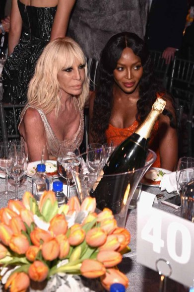 NEW YORK, NY - FEBRUARY 08: Donatella Versace (L) and Naomi Campbell attend as Moet & Chandon Toasts to the amfAR New York Gala At Cipriani Wall Street at Cipriani Wall Street on February 8, 2017 in New York City. (Photo by Bryan Bedder/Getty Images for Moet & Chandon) *** Local Caption *** Donatella Versace, Naomi Campbell