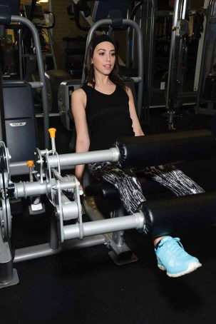 Miss Forestville Erika Farrell gets fit by working on her legs at JM Fitness.