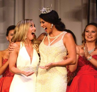 Eliza Lynne Kanner, Miss Fairfield County, left, reacts to winning the talent preliminary award Friday night at Miss Connecticut. She is standing beside Miss Connecticut Alyssa Taglia.