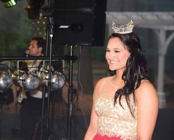 Miss Connecticut's Outstanding Teen Brooke Cyr greets the crowd as she makes her entrance for the first time Friday night.