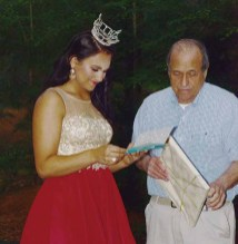 Miss Connecticut's Outstanding Teen Brooke Cyr receives a gift from a family member.